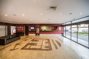 The lobby or reception area at Vila Gale Cascais