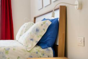 Letto o letti in una camera di Villa Vitali - Bellagio