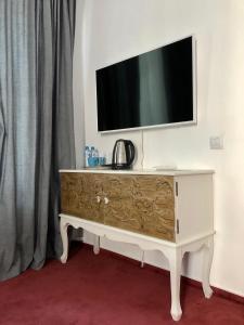 Телевизор и/или развлекательный центр в Boutique Hotel Khovansky