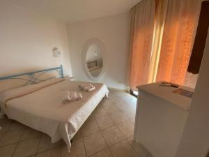 A bed or beds in a room at Palau City Hotel