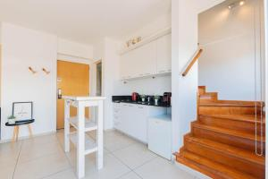 A kitchen or kitchenette at Modern&New Loft Puerto Madero