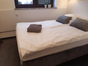 Łóżko lub łóżka w pokoju w obiekcie Bon Ton