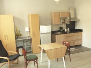 A kitchen or kitchenette at Hôtel des Thermes