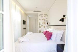 Uma cama ou camas num quarto em Hotel Lis - Baixa