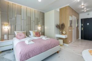 A bed or beds in a room at Apartpark - Ambria Apartments