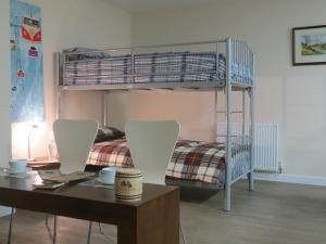 A bunk bed or bunk beds in a room at The Attic at Edenmill