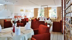 Ein Restaurant oder anderes Speiselokal in der Unterkunft Hotel Magnetberg