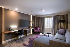 A television and/or entertainment center at Rydges South Bank Brisbane
