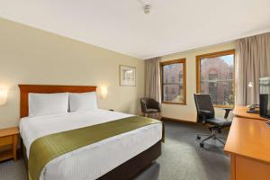 A bed or beds in a room at Rydges Sydney Harbour