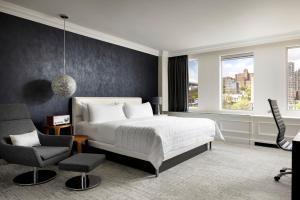 A bed or beds in a room at Le Meridien Versailles