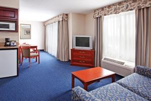 A television and/or entertainment center at Holiday Inn Express Hotel & Suites Cleveland-Richfield, an IHG Hotel