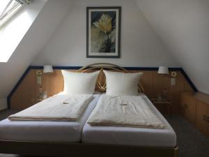 Ein Bett oder Betten in einem Zimmer der Unterkunft Hotel Bölke