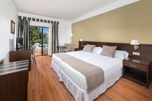 Cama o camas de una habitación en TRH Taoro Garden - Only Adults Recommended