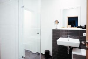 Ein Badezimmer in der Unterkunft Intermar Hotel & Apartments
