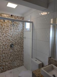 A bathroom at Palace Hotel Canela
