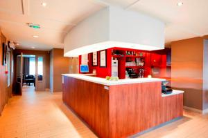The lobby or reception area at Campanile Metz - Jouy-Aux-Arches