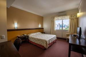 Cama ou camas em um quarto em Villa Vergueiro Hotel