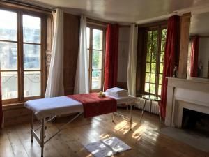 Un ou plusieurs lits dans un hébergement de l'établissement Maison d'hôtes de Charme