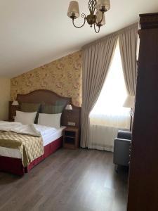 Кровать или кровати в номере Residence Hotel & Spa