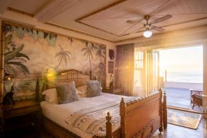 A bed or beds in a room at Tolcarne Beach Colonial Restaurant and Rooms
