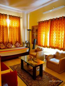 A seating area at CHIRAG HOME STAY - A Tranquil Bliss