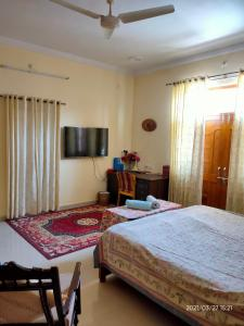 A bed or beds in a room at CHIRAG HOME STAY - A Tranquil Bliss