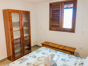 A bed or beds in a room at Hotel Fazenda Triunfo