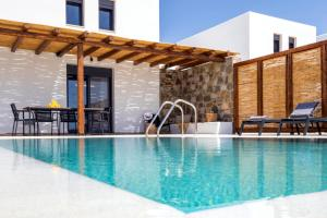 The swimming pool at or near Cato Agro 4, Seafront Villa with Private Pool