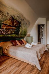 Łóżko lub łóżka w pokoju w obiekcie Apartament Gazdowski