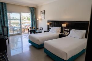 Ліжко або ліжка в номері Sierra Sharm El Sheikh