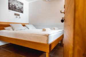 A bed or beds in a room at Guest House PachaMama Pleasant Stay