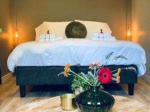 Een bed of bedden in een kamer bij Het Gouden Hert