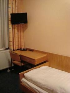 Телевизор и/или развлекательный центр в Hotel Gartenhof