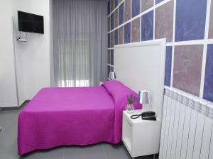 A bed or beds in a room at Orsa Maggiore Hotel