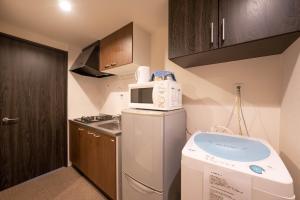 A kitchen or kitchenette at Stay Inn Kyoto Gojo