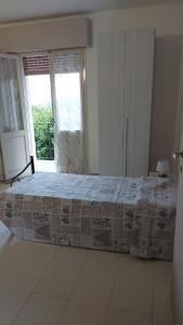 A bed or beds in a room at Comunità alloggio Bellavista