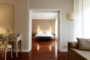 A bed or beds in a room at Silva Hotel Splendid