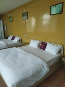 A bed or beds in a room at The Perch