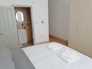 A bed or beds in a room at Forest House