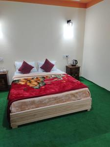 A bed or beds in a room at Hotel Snow Queen