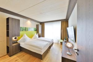 Ein Bett oder Betten in einem Zimmer der Unterkunft Mawell Resort