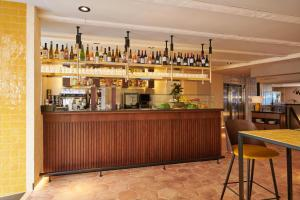 The lounge or bar area at Cosmo Hotel Boutique