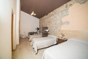 A bed or beds in a room at L'Otelet By Sweet