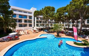 The swimming pool at or near Hotel & Spa S'Entrador Playa