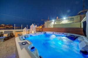 The swimming pool at or near Waterfront Valletta House