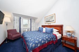 Кровать или кровати в номере Отель Кемпински Мойка 22