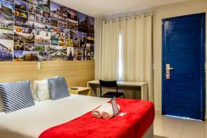 Ein Bett oder Betten in einem Zimmer der Unterkunft Injoy Suítes & Aparts