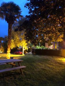 A garden outside Hotel Arcantis Le Voltaire