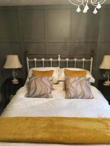 A bed or beds in a room at The Elms