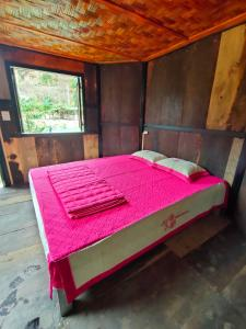 A bed or beds in a room at Indigenous homestay 1